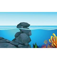 Scene with rocks under the ocean vector