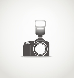 Photo camera sillhouette with the flash vector image