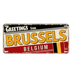 greetings from brussels vintage rusty metal plate vector image
