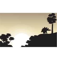 On the cliff stegosaurus scenery of silhouettes vector