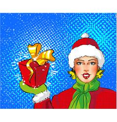 pop art girl in santa costume holding gift vector image vector image