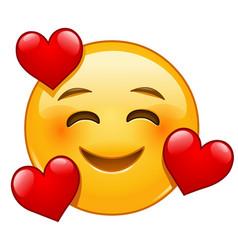 Smiling emoticon with 3 hearts vector