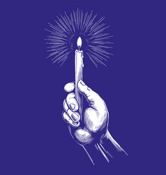 Hand holds burning candle shines in the dark hand vector