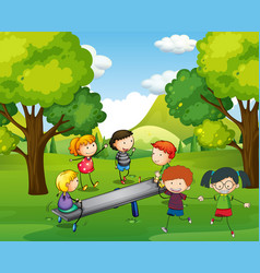 Happy children playing seesaw in park vector