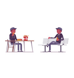 Young black man sitting at table on a white bench vector