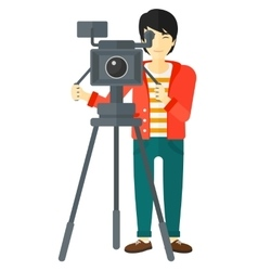 Cameraman with movie camera vector