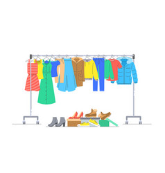 Clothes on hanger rack and shoes in boxes vector