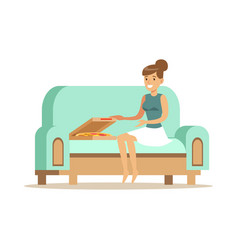 Beautiful girl sitting on a light blue sofa and vector