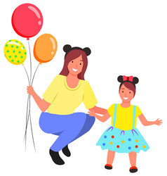 mother holding balloons standing kid daughter vector image