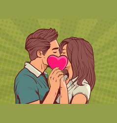 young couple kissing hollding pink heart man and vector image vector image
