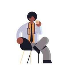 male doctor in white coat having coffee break vector image