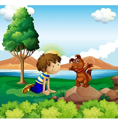 A young boy and his pet near the lake vector image vector image
