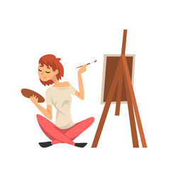 Male artist drawing picture with brush on easel vector