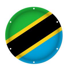 Round metallic flag of tanzania with screw holes vector