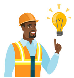 African-american builder pointing at light bulb vector