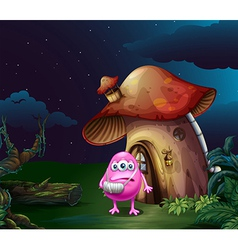 An injured pink monster near the mushroom house vector image