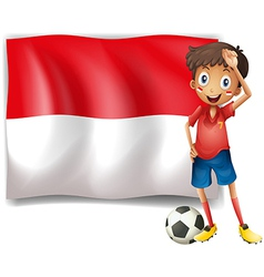 A boy with a soccer ball standing in front of the vector image vector image