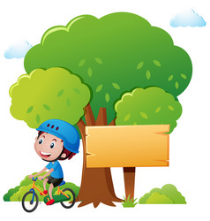 park scene with boy riding bike vector image