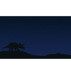 Silhouette of triceratops at night landscape vector image