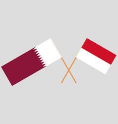 Indonesian and qatari flags vector