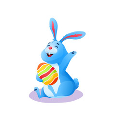 Cute happy cartoon easter rabbit with painted egg vector