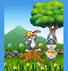 happy rabbit holding easter egg on the field vector image