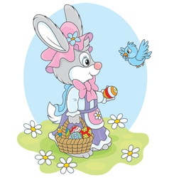 Easter Bunny with a basket of eggs vector image vector image