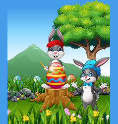 easter backround with bunnies and big easter egg vector image