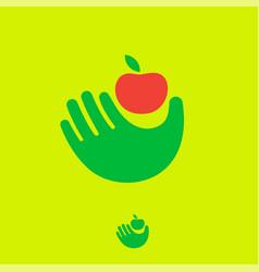 Organic fruit emblem hand keeping ripe apple vector