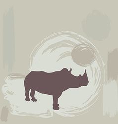 rhino silhouette on grunge background vector image