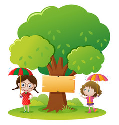 two girls with umbrella in the park vector image