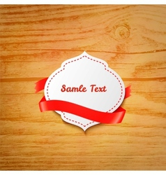 Label with ribbon over wooden background vector image vector image