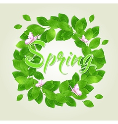 Round floral frame with green leaves vector image