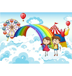 A carnival in sky with a rainbow vector