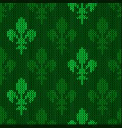 Knitted woolen heraldic lily green tones vector