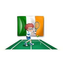 A boy playing tennis in front of the Ireland flag vector image vector image