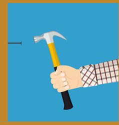 man holding hammers a nail into a wall vector image
