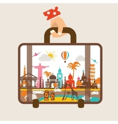 Hand holding luggage travel around the world vector