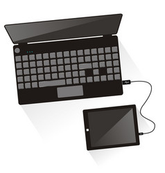 laptop connected to tablet top view vector image vector image