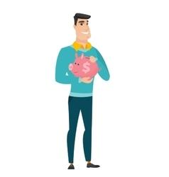 Caucasian business man holding a piggy bank vector image