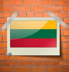 Flags Lithuania scotch taped to a red brick wall vector image