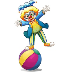 A playful male clown at the top of a ball vector image