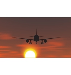 The plane is taking off at sunset vector image vector image