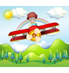 A boy riding in a red plane vector