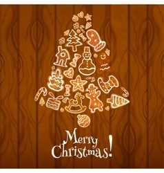 Christmas bell with gingerbread on wooden texture vector image vector image
