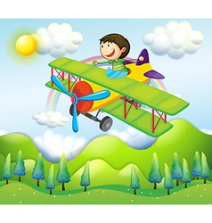 A young man riding in a colorful plane vector image