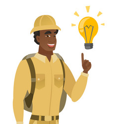 African-american traveler pointing at light bulb vector