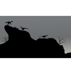 Eoraptor in cliff silhouette at night vector