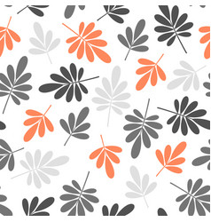 Seamless stylized grey and orange leaves pattern vector