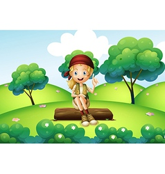 A girl sitting on the trunk at the hill vector image vector image